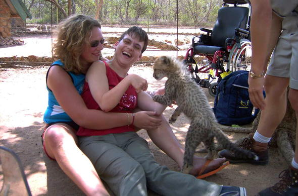Cheetah cub interaction brings a smile to a physically challenged traveller.