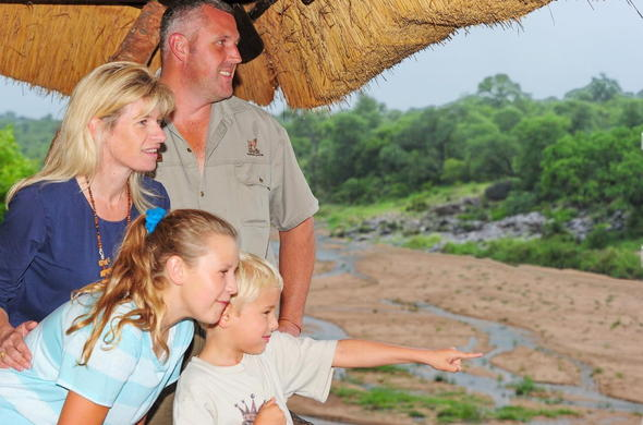 Kids spotting wildlife during a Kruger Park family safari.