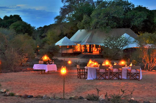 Enjoy dinner under the African sky.