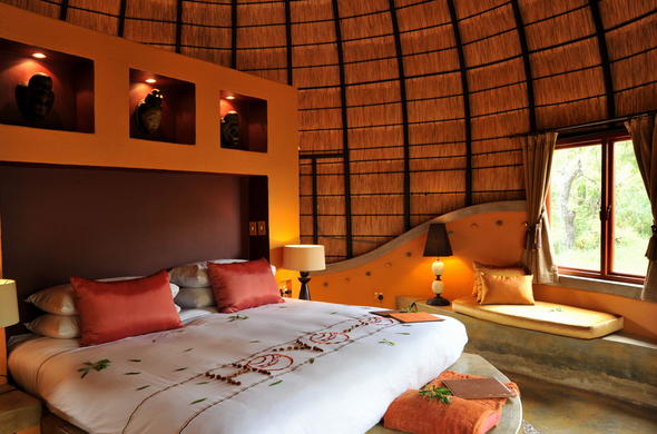 Comfortable thatched roof suite at Hoyo Hoyo Safari Lodge.