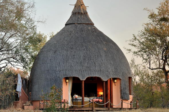 Traditional beehive hut accommodation at Hoyo Hoyo.