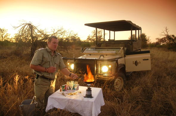Sundowner drinks at a scenic spot in the Kruger Park.