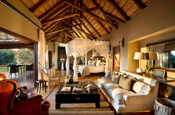 Luxurious Lion Sands Tinga Lodge suite with lounge and private patio.