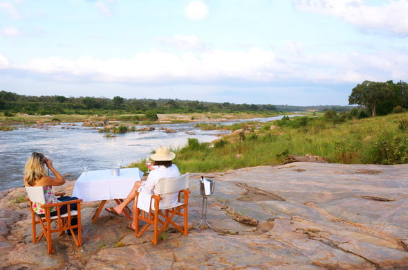 Sundowner drinks by the Mjejane River.