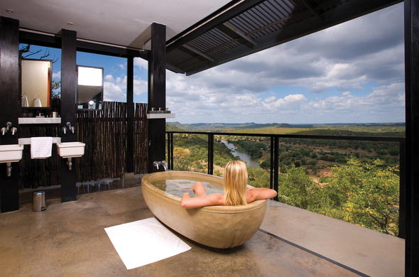 The exquisite Outpost Lodge bathrooms with alluring bush views.