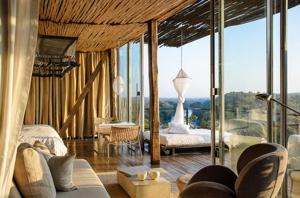 The stunning Singita Lebombo Lodge deck area has a daybed.