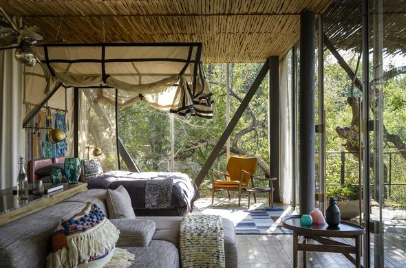 Enjoy a luxurious stay in the opulent suites at Singita Sweni Lodge.